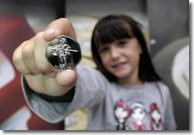 Nine-year-old Florence Jackson with the London 2012 50p she designed for the Royal Mint